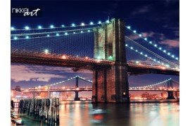 Brooklyn Bridge close up over East River at night in New York City