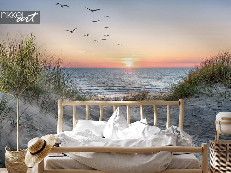 Fotobehang strand bij zonsondergang