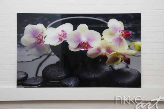 Keuken foto achterwand spa concept –branch yellow orchid in bowl with stones