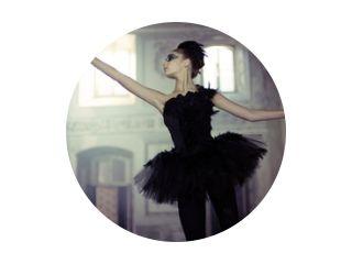 Black swan ballet dancer in move