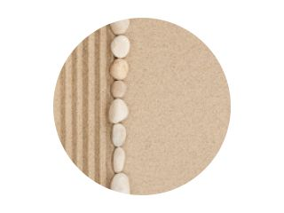 Stripe of white stones lying on the sand