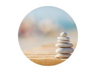 zen stones jy wooden banch on the beach near sea. Outdoor