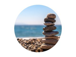 creating a composition by stacking stones at the seaside