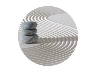 Japanese ZEN garden with stacked rocks in white textured sand