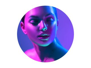 High Fashion model woman in colorful bright neon lights posing in studio, night club. Portrait of beautiful girl in UV. Art design colorful make up. On colourful vivid background,