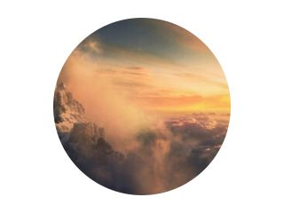 Beautiful aerial landscape of mountain peak at sunset above the clouds - panoramic
